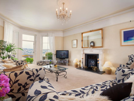 The spacious, light-filled lounge with gorgeous views across the River Teign in Salty House