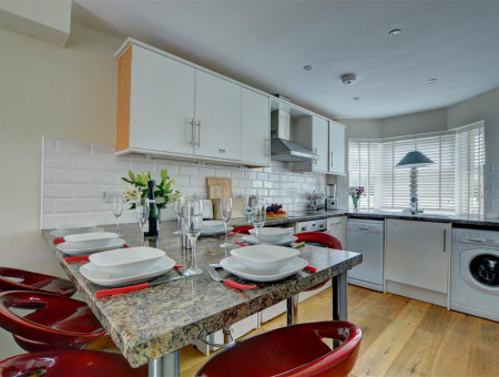 The well equipped kitchen is separated from the lounge area by a large breakfast bar ideal for informal dining
