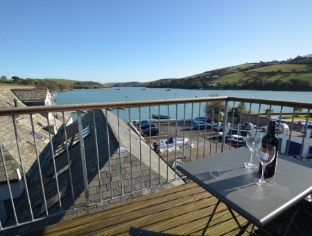 Balcony with a bistro table and chairs/stools. Views over Salcombe harbour and East Portlemouth.