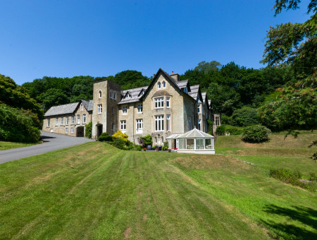 Sheplegh Court was constructed in the early 1800's and is set in 22 acres of beautiful tranquil grounds nestling in the folds of a lovely valley with extensive gardens, woods, parkland and views across glorious South Devon countryside.
