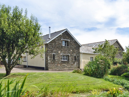 Nestling within a beautiful green valley on the edge of the Exmoor National Park, Honeysuckle Cottage enjoys stunning views