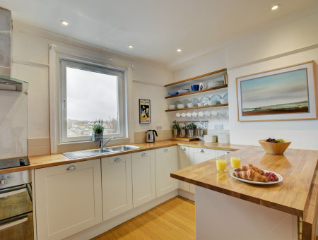 Kitchen: Lovely contemporary country style fitted units and wooden family table with bench seating large enough to seat 5 people, washer/dryer, fridge with a freezer compartment and a built in cooker with a grill.