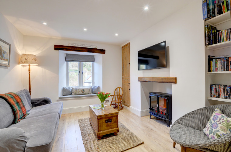 The open plan living area with comfy settee, and cushioned window seat ideal for enjoying the views