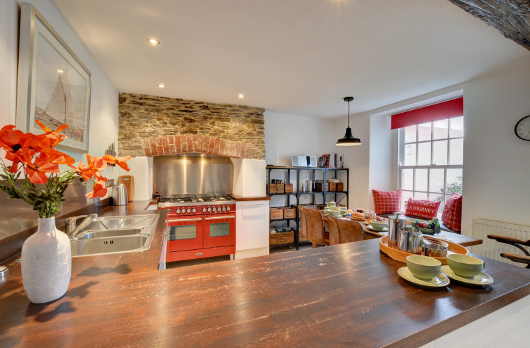 Stylish kitchen with window seat that looks out onto the garden