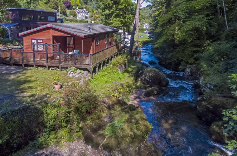 Set in a beautiful wooded valley overlooking the West Lyn River