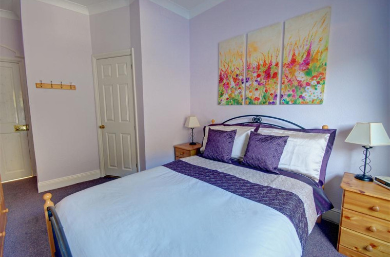 Bedroom with double bed and en suite shower room with WC and basin