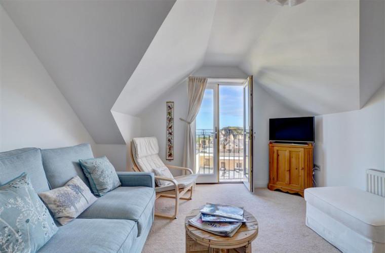 Open plan sitting room with pretty Juliet balcony