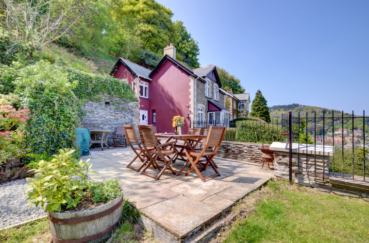 This charming detached cottage is quietly tucked away on a steep hillside overlooking the village of Lynton