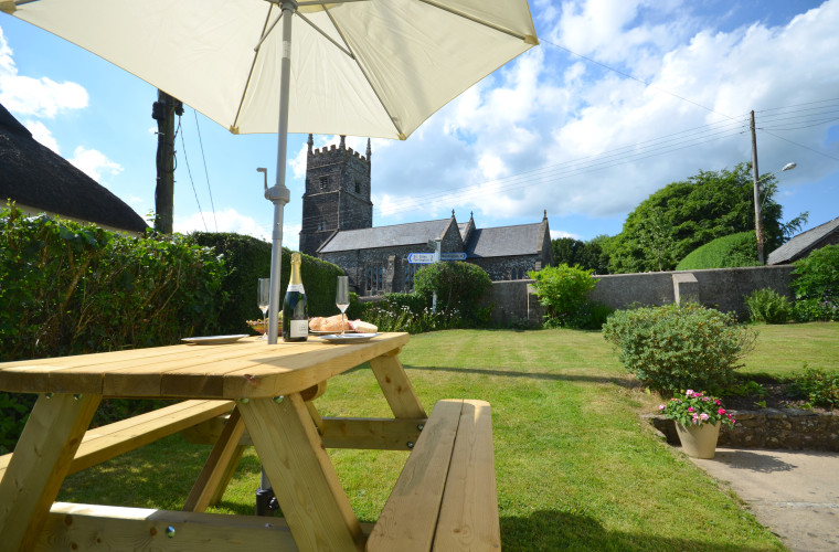 A private garden is the perfect place for guests to eat alfresco and soak up the views