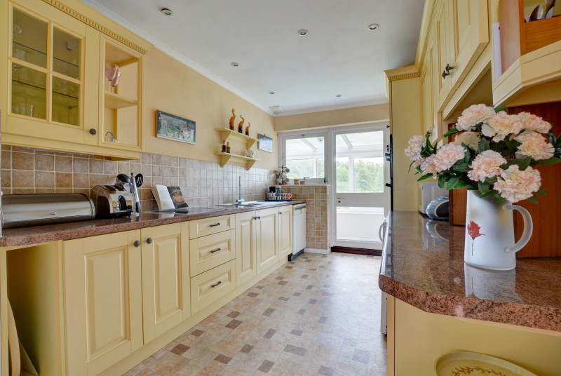 Well equipped kitchen with handy serving hatch