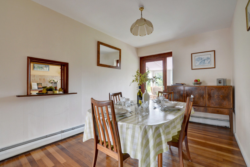 Lovely dining room with access to the conservatory