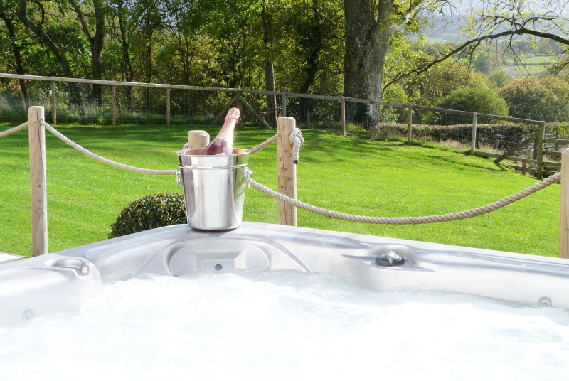 Stunning large hot tub with amazing views across the valley.