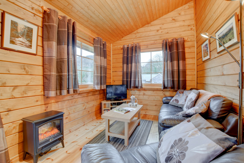 Welcoming lounge at this cosy log cabin in Snowdonia