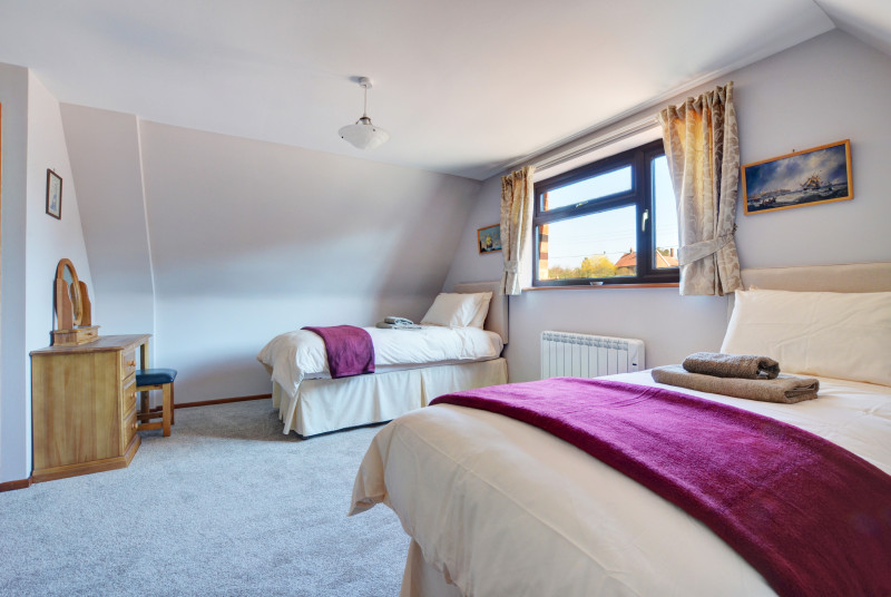 Bedroom three is very spacious with twin beds
