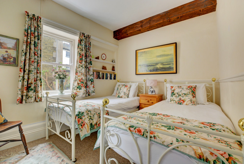 Pretty double bedroom with wrought iron twin beds, ideal for children