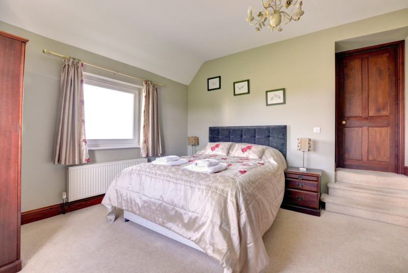 King-size bed in bedroom 1