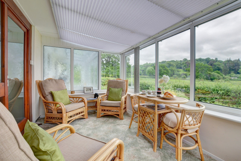 The conservatory offers lovely garden and countryside views