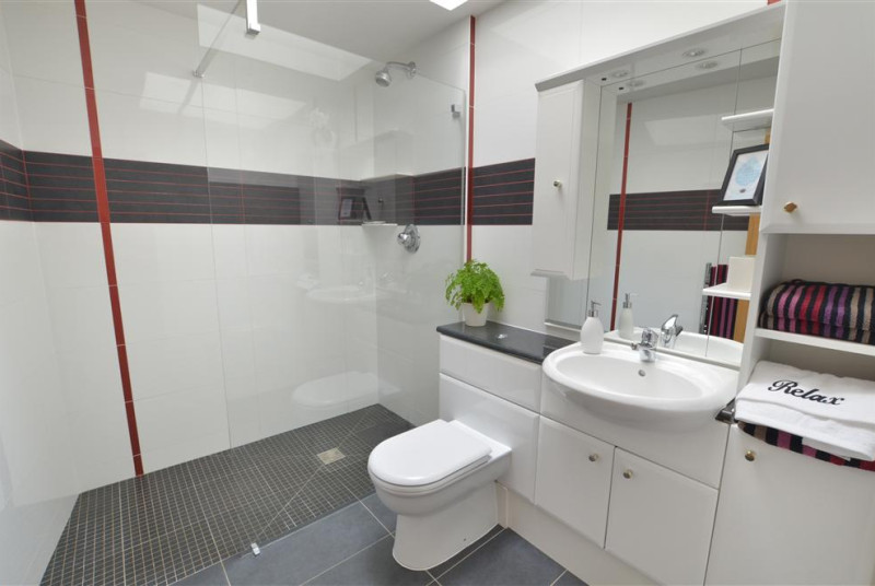The en-suite shower room to bedroom two has a large shower area