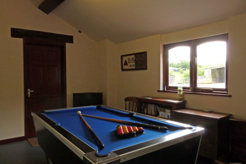A converted outbuilding on the farm yard also serves as a laundry and games