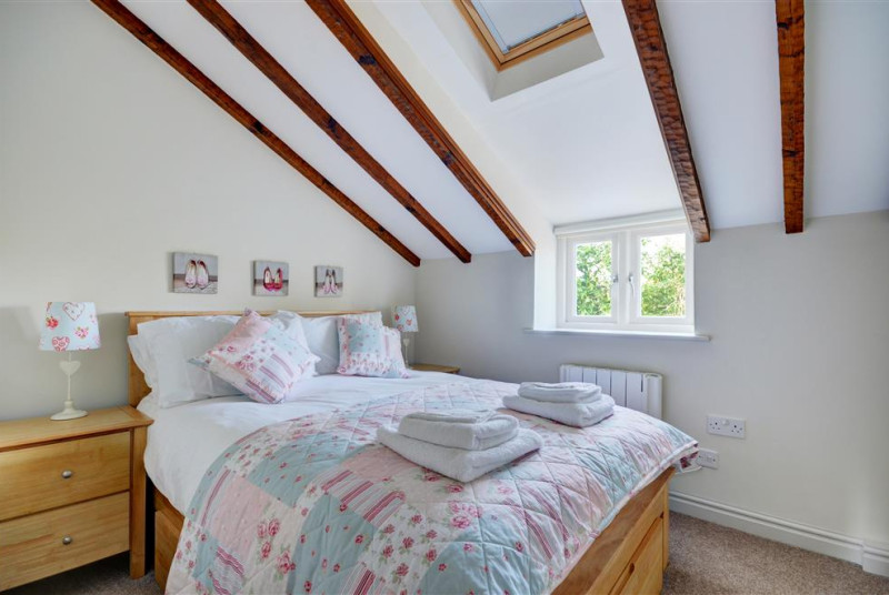 Bedroom two is attractively furnished with a double bed