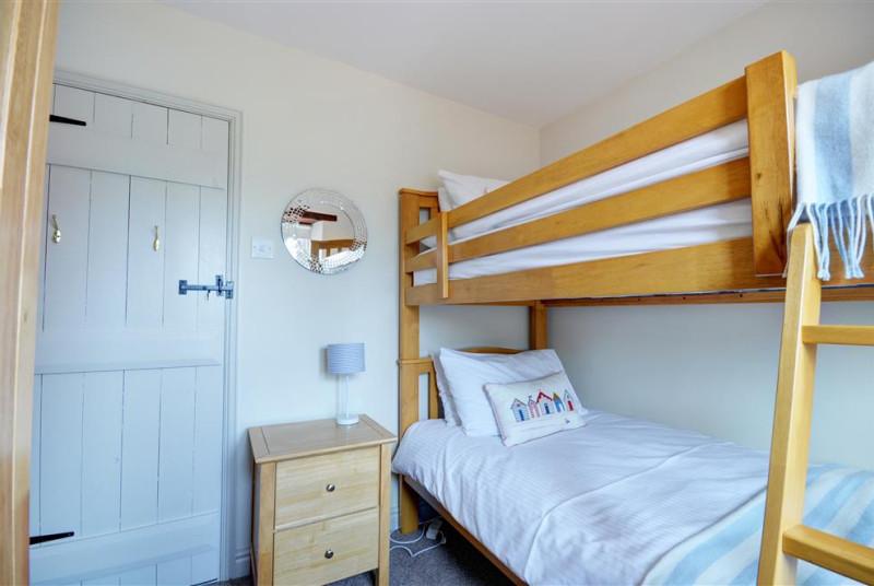 Bedroom three has bunk beds and storage