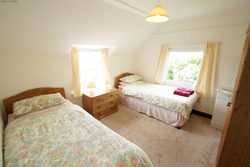 Second twin bedroom with sea and countryside views
