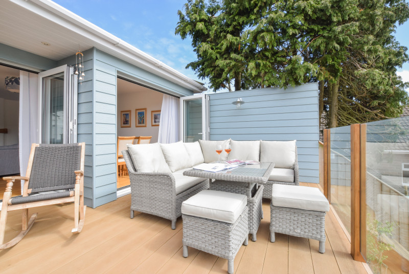 Decking area with wicker furniture, great for a BBQ and relaxing in the evening