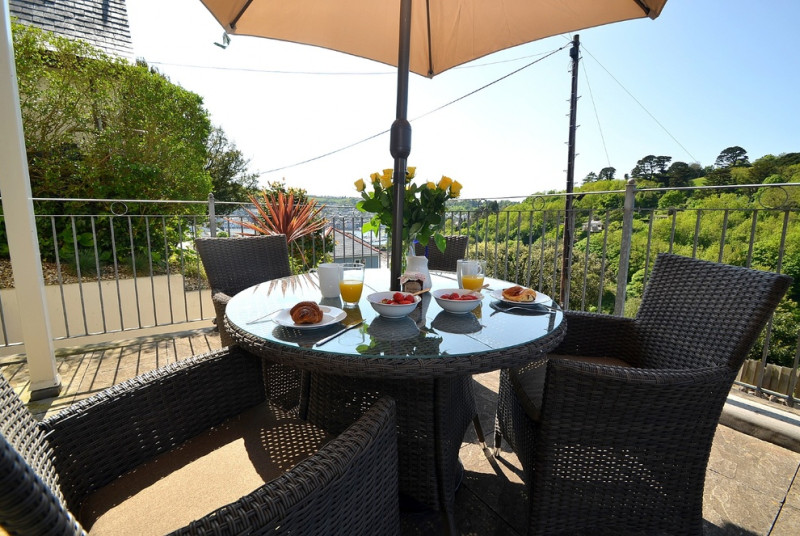 Outside: Large private terrace with far reaching views across the River Dart. Table, chairs and barbecue.
