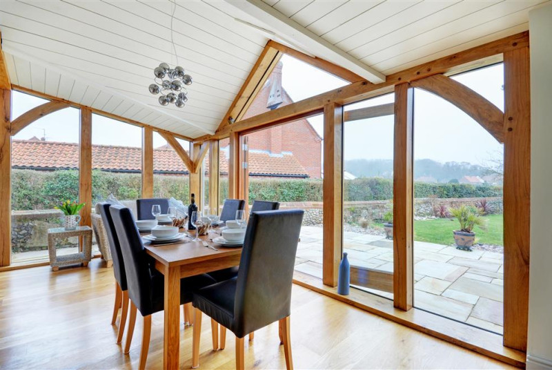 The garden room is a stunning room with dining table
