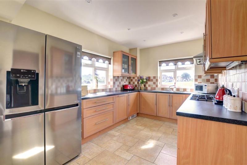 Kitchen area with large fridge