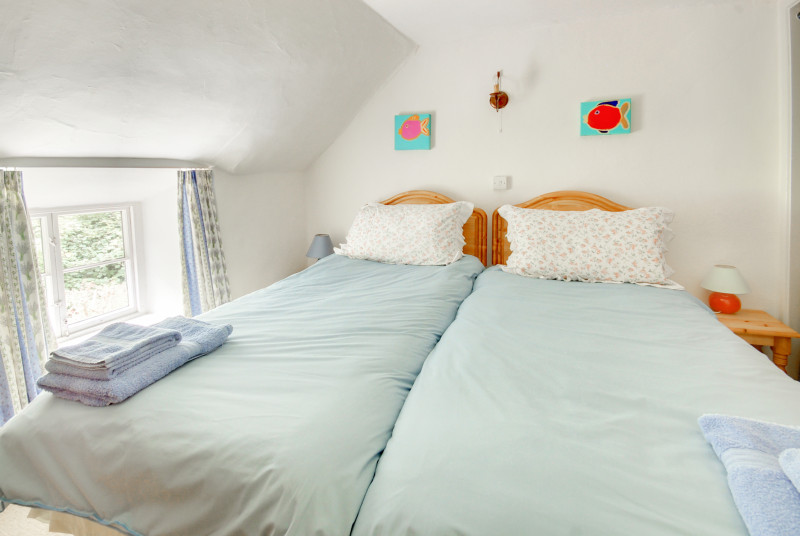 Twin bedroom with sloping ceiling