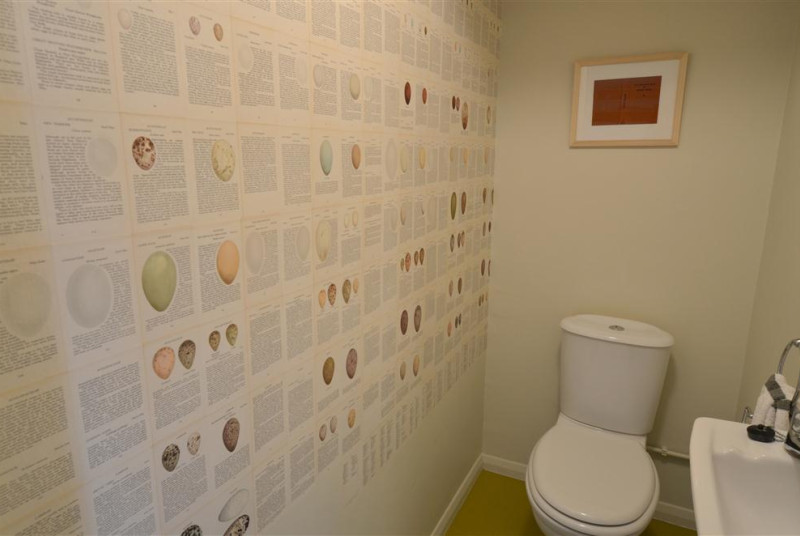 Enjoy looking at all the eggs on the wall in this convenient downstairs loo at the property.