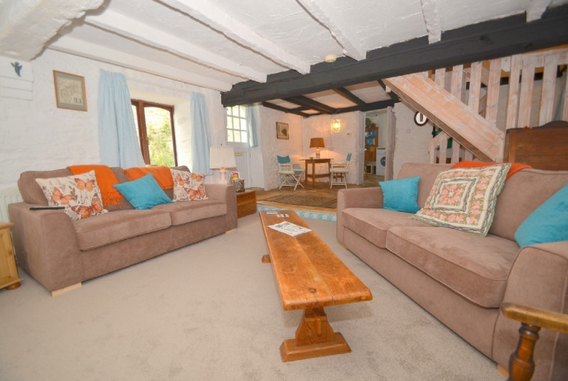 Living room/dining area: An open plan spacious area on two levels. The lower level is for relaxed living with 2 sofas, chair, gas woodburning stove, flat screen TV, DVD player and a selections of DVD's. The raised level is the dining area with circular ta