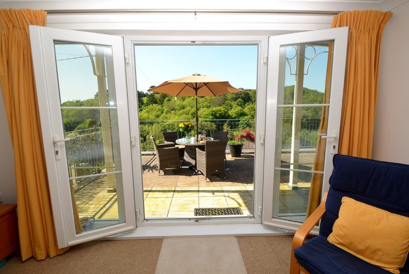 Patio doors leading out to the furnished terrace