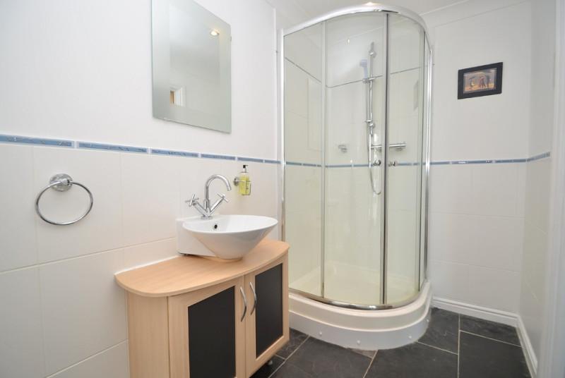 Master bedroom's modern white en-suite shower room
