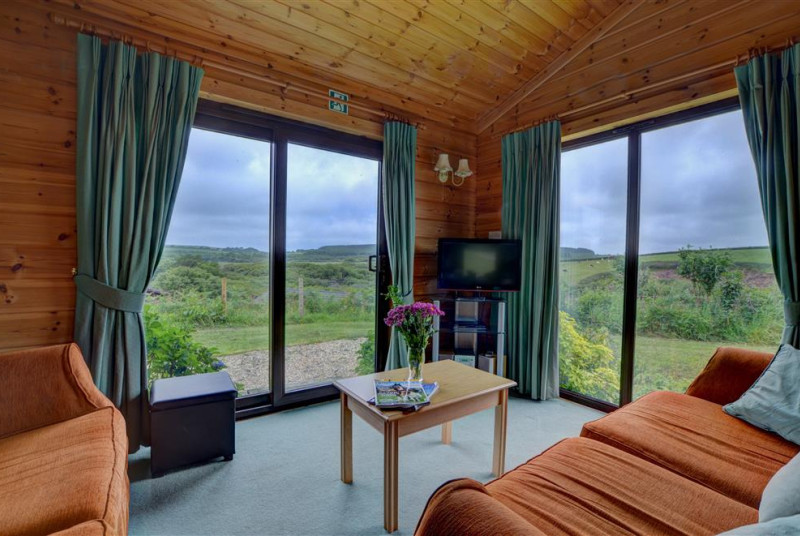 Comfortable sofas and stunning countryside views from the sitting area
