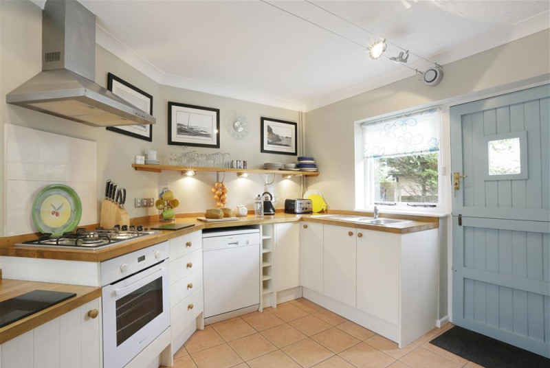 In the early morning sun this kitchen provides a bright space to prepare breakfast for those hungry guests.